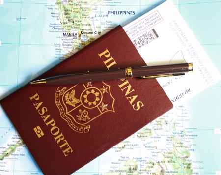 philippines  map: Philippines passport with pen and boarding pass over map background