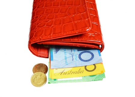 Red leather wallet filled with Australian dollars  photo