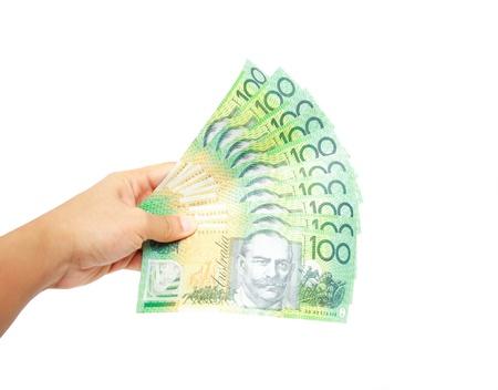 show bill: Montones Woman hand holding de 100 billetes de banco australianos