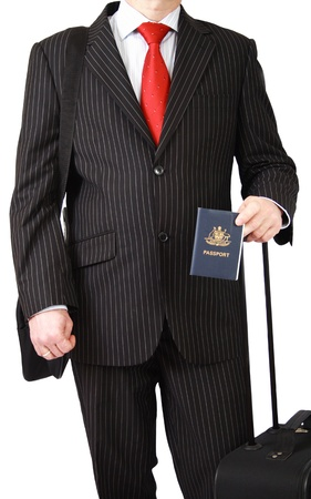 Businessman in black suit with Australian passport isolated on white photo