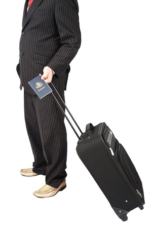 Businessman holding Australian passport and travelling bag photo