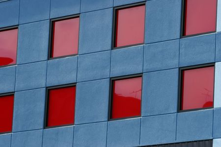 Red paneled windows on blue building