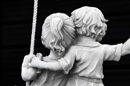 Statue of couple on swing