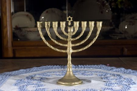 Menorah on table with blue and white table cloth Stock Photo