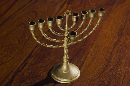 judah: Angle view of Menorah with wood background