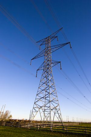 Hydro electric power lines against a blue sky Imagens