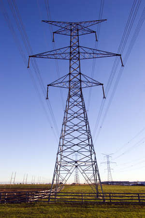 hydro electric: Hydro electric power linesagainst a blue sky Stock Photo