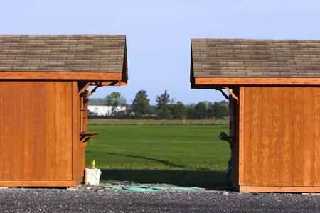 Two wooden sheds facing each other Stock Photo