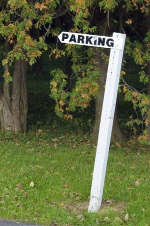 post: Leaning post with parking sign atop