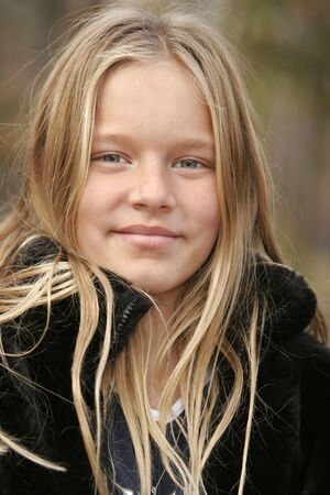 Young girl with messy blond hair taken with narrow DOF Stock Photo