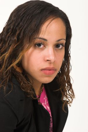 Portrait of an Afro-Amrican woman wearing a pink t-shirt and a black jacket.