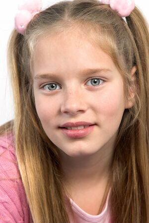 Young girl in pink with long blond hair.