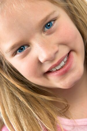 Young blond girl with a big smile. Banco de Imagens