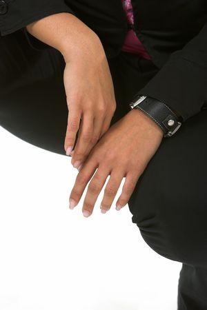 Una mujer de manos como ella sqatting.  Foto de archivo - 798598