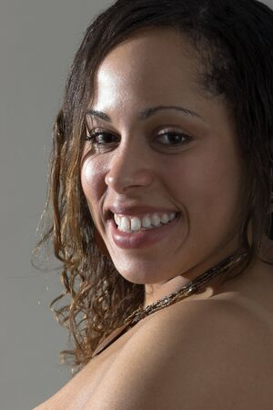 Beautiful smiling Afro-American woman with  bare shoulders