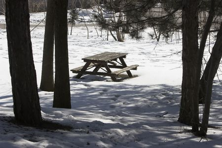 Picnic bench in the park but taken during the winter. Stock Photo