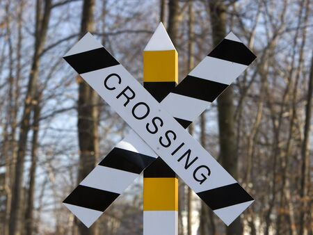 Black and white and yellow crossing sign