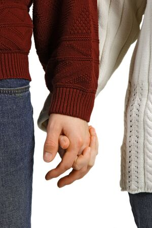 Young couple in love, holding hands against a white background. photo