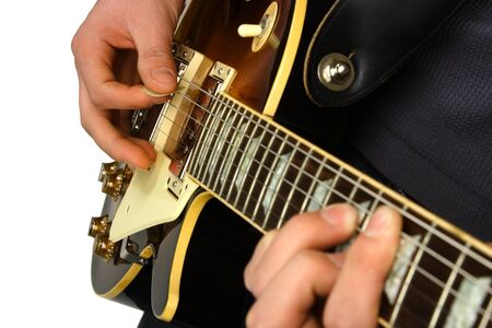 chords: Close up of an electric guitar being played.