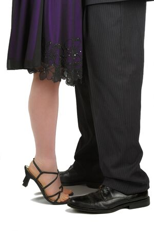 Feet of couple in formal wear with her standing on her tip-toes Stock Photo