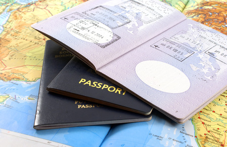 Travel concept; passport and map
