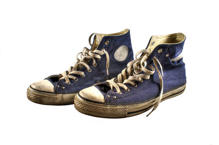 A pair of old blue sneakers isolated