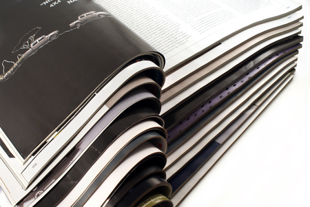 Stack of different open magazines - close-up