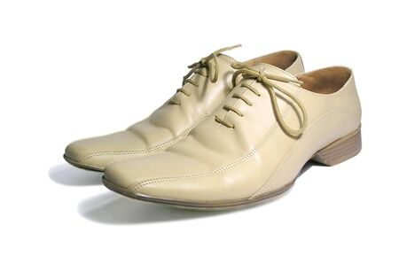 White mans low shoes on a white background