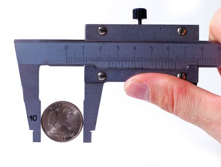 micrometer: The micrometer measures Rubles a coin. The concept of accuracy and quality.