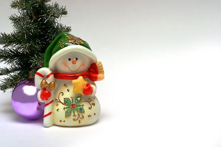 christmastree: Christmas card with a snowman and christmas-tree decoration Stock Photo