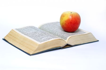 Apple and book on white background photo