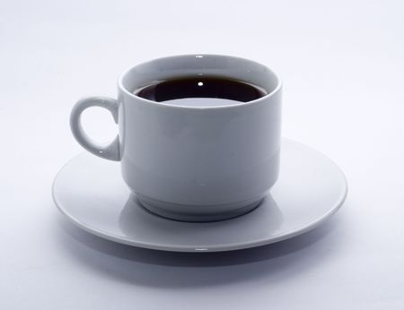 White cup of black cofee on white background photo