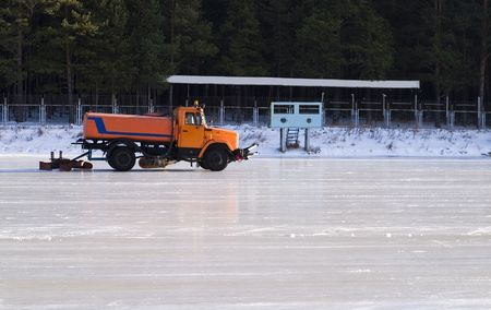 Fill in skating rink by ice machine photo