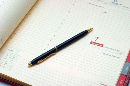 Business stuff - pen and agenda. Business concept.   photo