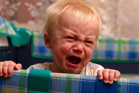 Close-up upset baby boy crying