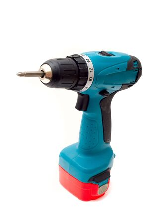 Drill Cordless screwdriver. Powerful and convenient tool. Isolated on a white background photo