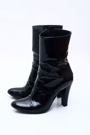 Womens patent leather boots with a heel photo