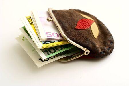 Purse full of euros on a white background photo