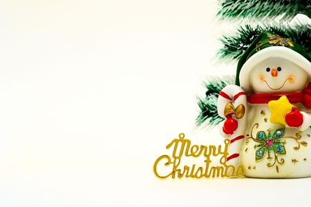 Cristmas card with snowman and cristmas-tree photo