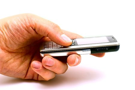closeups: The hand of man holding the mobile phone isolated