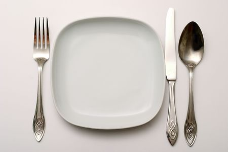 Cutlery: a plate, spoon, knife with a fork. photo