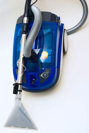 Modern washing vacuum cleaner on grey background. photo