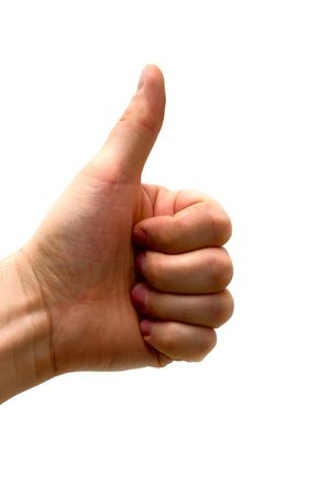 Hand with the thumb lifted upwards - an approval sign photo