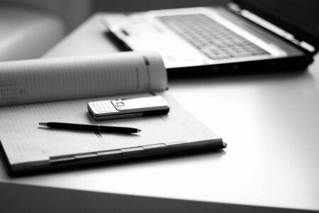 Tools businessman: a laptop, diaries, phone Stock Photo