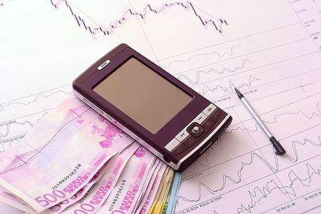 electronic balance: Comunicator aginist banknotes euro and stock market reports