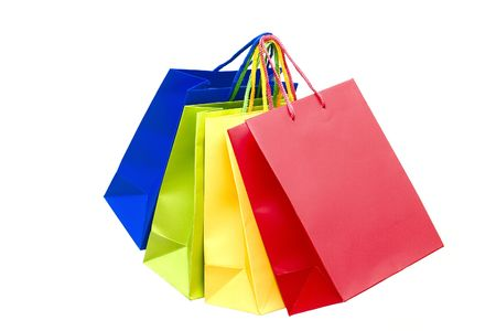 Multi-coloured packages for purchases are isolated on a white background.