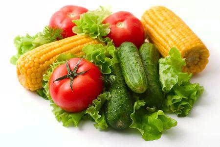 Vegetables: tomatoes, cucumbers and corn. Vivid healthy nutrition. Studio lighting.