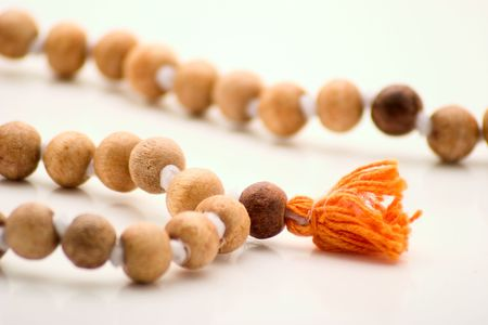mudra: Vedic wooden rosary consisting of 108 beads. Their help  devoted Krishne,  daily repeat morning prayer 1728 times. Stock Photo