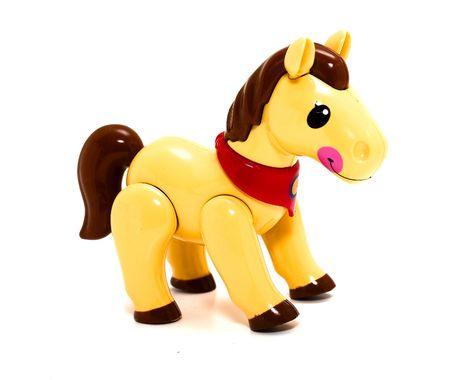 racehorses: Leuk speelgoed paard op een witte achtergrond. Conceptie van cadeau voor kinderen.