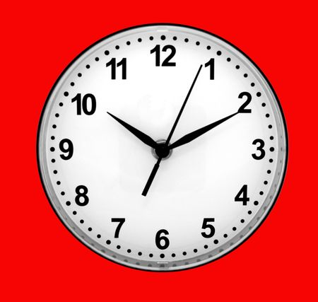 12 oclock: Dial of clocks with arrows on a red background. Stock Photo